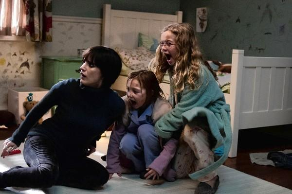 "Jessica Chastain, left, Isabelle Naílisse and Megan Charpentier in ""Mama."""