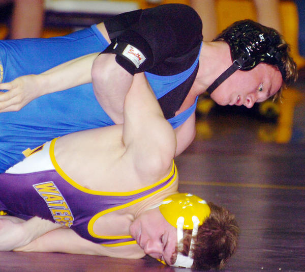 Aberdeen Central's Griffin Hieb attempts to turn Watertown's Taylor McLaughlin at 138 pounds during Thursday night's Eastern South Dakota Conference wrestling dual at Watertown. Hieb won by fall in 1:34, helping the Golden Eagles take the dual 48-19.