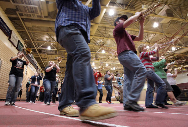 Members of the Northern State University Marching Wolves make their way around the track inside the Barnett Center during a rehearsal Wednesday night. The group is getting ready to march in the President's Inaugural Parade in Washington, D.C.