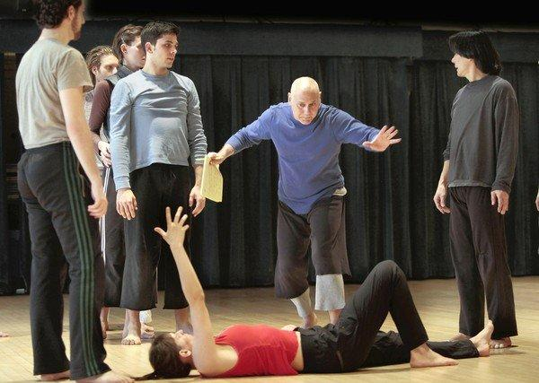 Choreographer-director Doug Varone (blue shirt) and members of his dance company rehearse in Buttenwieser Hall in New York.