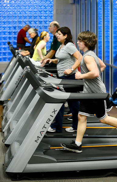 Alex Jones, 16, of Waynesboro, Pa., gets a workout on a new treadmill at the Waynesboro YMCA. Nest to Jones is Dawn Keller. The Waynesboro YMCA recently added new equipment to its facility.