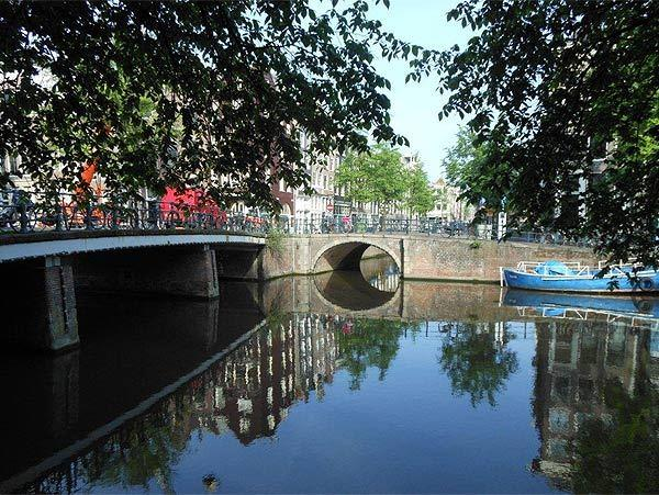 "This picture was taken by Mary Ann Gravel of Clermont while walking along a canal en route to tour Ann Frank's house in Amsterdam, Holland. ""The reflection of the buildings in the water looked almost as if they are in a painting,"" says Mary Ann."