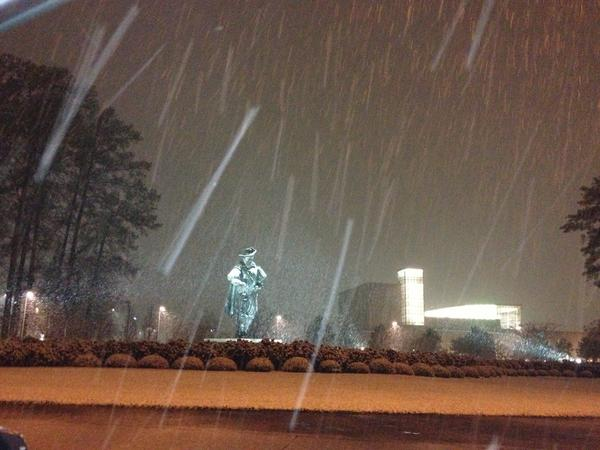 Snow falls at Christopher Newport University late Thursday night.