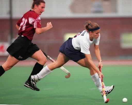 UConn Field Hockey wins their second Big East Championship. Here is Laura Klein of the 1999 UConn team dribbling past a Hartford defender during a game.