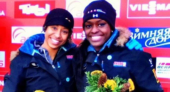 Aja Evans (r) and Jazmine Fenlator at the awards ceremony Friday in Igls, Austria.