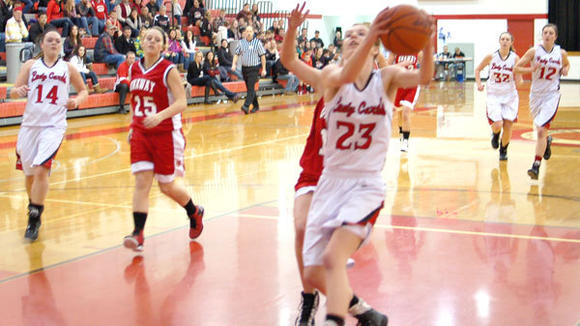 J-L freshman Madison Showerman gathers herself under the basket during the Lady Cards' blowout victory against Onaway Wednesday.