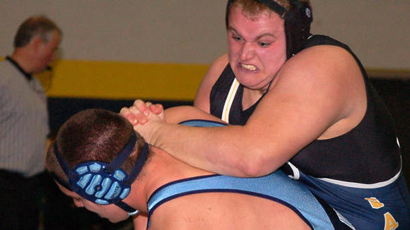 Gaylord wrestler Danny Miller puts his all into a battle with Petoskey's 275-pound grappler.