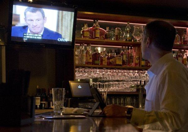 A man watches Lance Armstrong's interview with Oprah Winfrey at a downtown Los Angeles bar on Thursday.