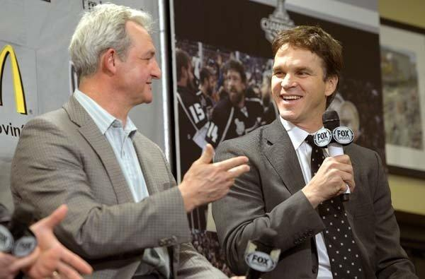 Coach Darryl Sutter and executive Luc Robitaille take part in the Kings' season-opening news conference last week at Staples Center.