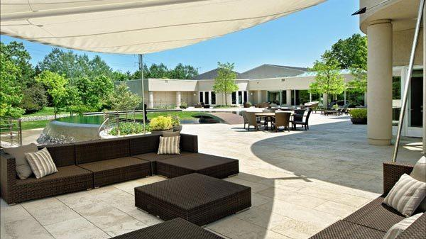 A large patio over looks a small putting green.
