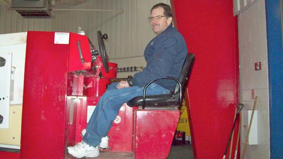 Rick  Smigelski, the  ¿Zamboni Man,¿ clears the ice at the Otsego County Sportsplex. He now enjoys his more active lifestyle after losing 154 pounds.