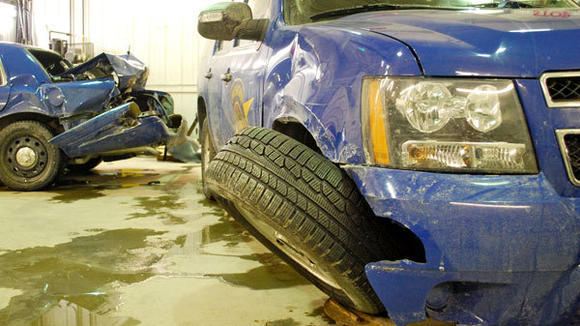 These Michigan State Police vehicles, shown Thursday at Totten¿s Body Shop in Gaylord, were damaged by vehicles driven by Eric Ramsey, who was killed by a Crawford County Sheriff's Department deputy