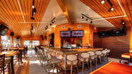 Hooters revamps its look, aims to be a family restaurant