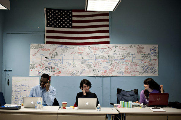 Volunteers make phone calls to re-elect President Obama at the campaign's Field Office in Chicago.