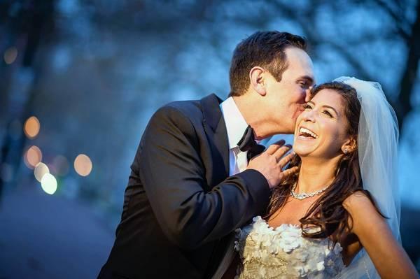 Ashley Lebow and Elliot Mutch share a laugh on their wedding day.