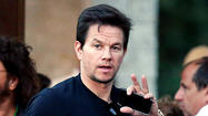 A former Blackberry addict, actor Mark Wahlberg looks at my phone and mentions he just bought his first iPhone 5.