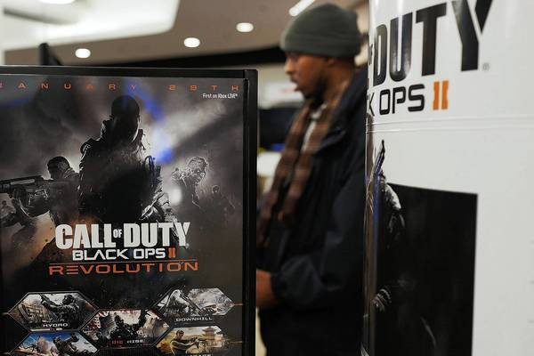 "An advertisement for the game ""Call of Duty: Black Ops 2"" is viewed at an electronics store in New York City."
