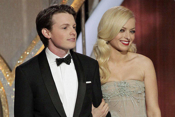 Sam Fox and Francesca Eastwood, children of Michael J. Fox and Clint Eastwood, respectively, helped out Sunday at the Golden Globe Awards.
