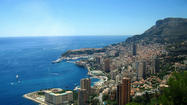 Roughly the size of New York's Central Park at three miles long and one-and-a-half mile wide, Monaco not only enjoys an incredible setting between the Mediterranean and the Alps and between the French and Italian Rivieras, but could be said to be Europe's own central park –a once-upon-a-time Mediterranean port of call with a royal palace and streets filled with Ferraris, Mercedes Benzes, Rolls Royces and other luxury cars, designer boutiques and sidewalk cafes.