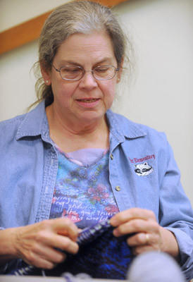 Mardi Metzger, of Bethlehem and a member of the Caring Crafters, knits a blanket at the Knitter's Edge on Thursday. The Caring Crafters is a charity knit and crotchet group that gathers on Thursdays from 3:30-5:30 at the Knitter's Edge in Bethlehem. They started making chemo caps for people having chemotherapy and have expanded to donating to Nurse Family Partnership, hospitals and military abraod.