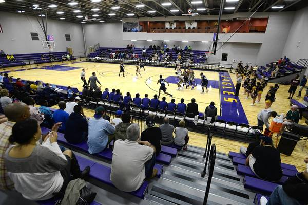 Fans watch a high school basketball game in a new gymnasium between Dr. Phillips and Montverde Academy in Montverde, Fla., last month.