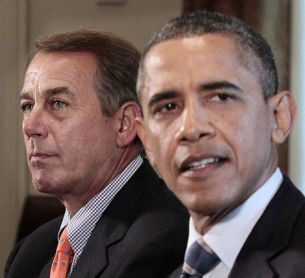 In this photo from July 2011, House Speaker John A. Boehner (R-Ohio) listens as President Obama speaks during a White House meeting with congressional leadership to discuss deficit reduction.