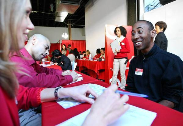 Angele Thomas, 25, right, interviews for a job at a Target store in Los Angeles that is scheduled to open in March.