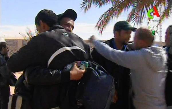 In an image from television, freed hostages hug each other in the town of In Amenas, Algeria.