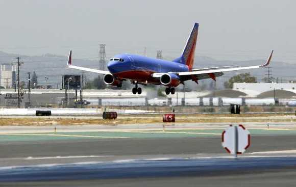 A Southwest flight lands at Bob Hope Airport. The airfield is purchasing an emergency lighting system in case its runway lights go out again.
