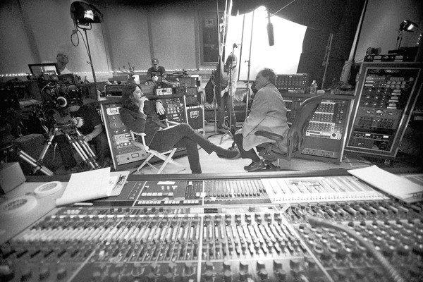 "Dave Grohl seated at left in studio. Grohl's directorial debut ""Sound City"" is set to premiere at the Sundance Film Festival. His documentary examines the history of the Van Nuys recording Studio."