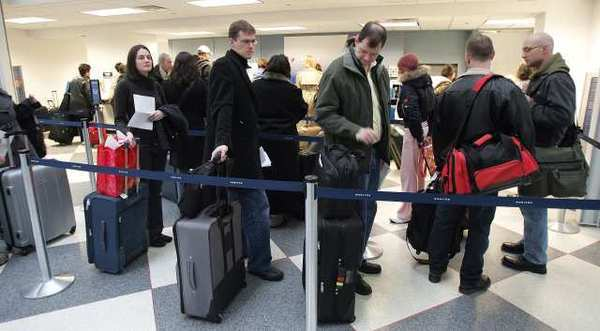 An airline expert predicts more airlines will begin to charge passengers for carry-on bags.