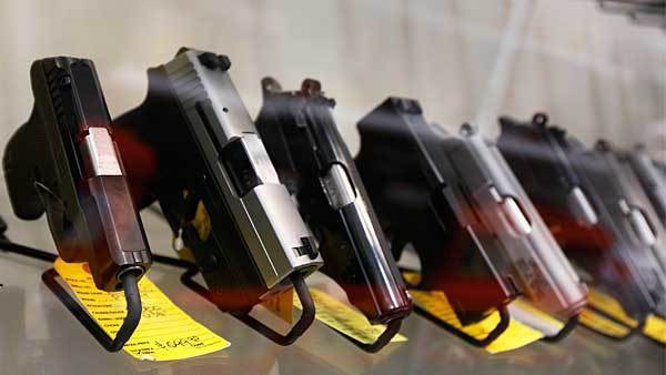 A display of 7-round handguns are seen at Coliseum Gun Traders Ltd. in Uniondale, New York January 16, 2013.