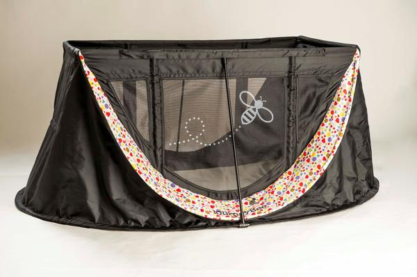 The pop-up JourneyBee Travel Crib comes in several colors and patterns
