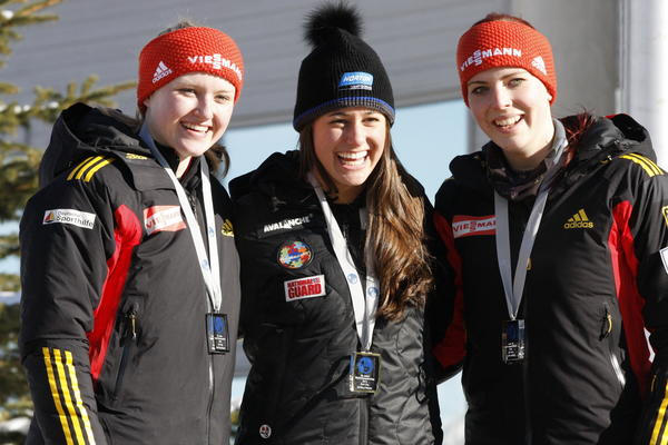 From left, Caroline von Schleinitz (silver), Emily Sweeney (gold) and Nathalie Burkhardt (bronze) pose at the medal ceremony.