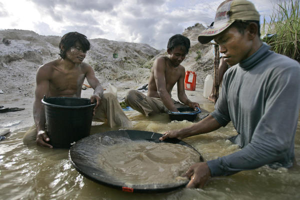 Traditional miners pan for gold at a mine in Hampalit, Indonesia. Soaring prices for the precious metal have given rise to a doubling of toxic mercury emissions over the last eight years from unregulated gold processing at tens of thousands of remote sites, mostly in Asia, Latin America and Africa.