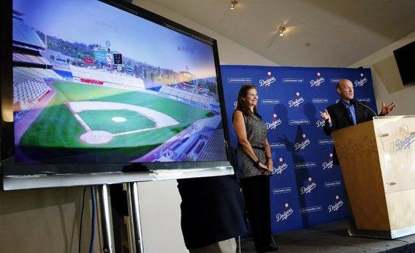 Stan Kasten, president and CEO of the Dodgers, right, and Janet Marie Smith, senior vice president of planning and development, speak about improvements to Dodger Stadium on Jan. 8.