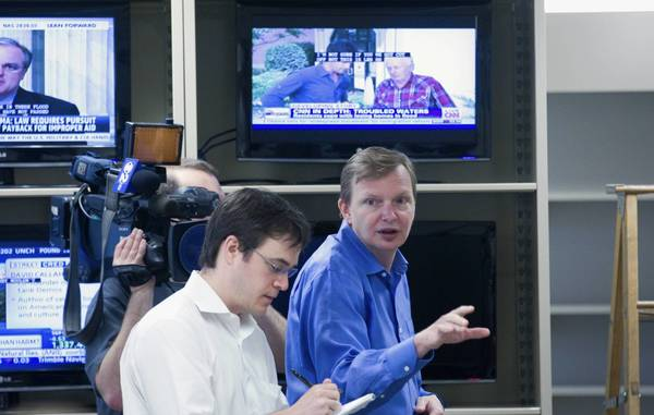 President Obama's 2012 campaign manager, Jim Messina, right, will be chairman of the board at Organizing for Action.