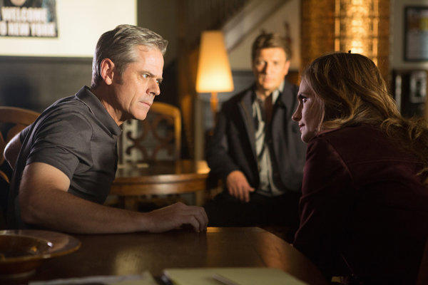"A scene from ABC TV series ""Castle"" with C. Thomas Howell, left, Nathan Fillion (background) and Stana Katic."