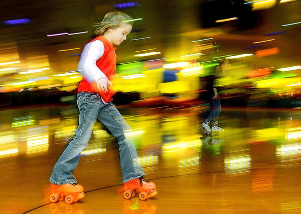 Mikayla Stambaugh, 9, of Clear Spring roller skates to the music at Turner's Skate Palace on Virgina Avenue Friday.  Skaters were part of the YMCA After School Program.