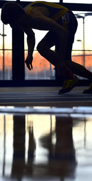 A runner participating in the Washington County Indoor Track Championships at Hagerstown Community College Friday takes off running at the sound of the starter pistol.
