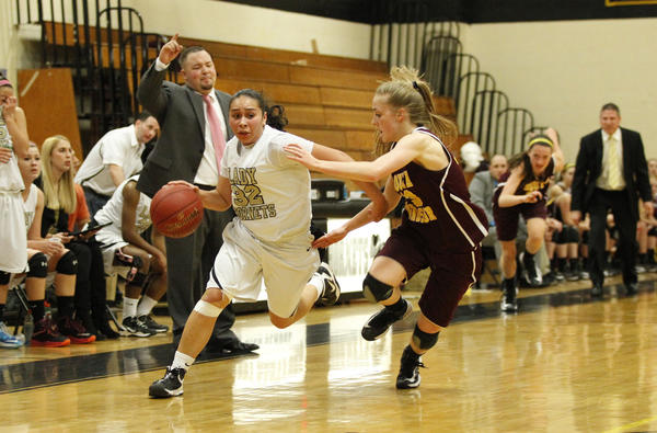 East Hartford Hornets guard Briana Gerena drives against South Windsor Bobcats forward Olivia Bolden during the second half at the East Hartford High School. South Windsor won, 52-48.