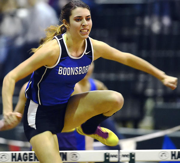 Boonsboro's Maggie Sullivan races to victory in the girls 55-meter hurdles Friday at the Washington County Indoor Track & Field Championships at Hagerstown Community College.