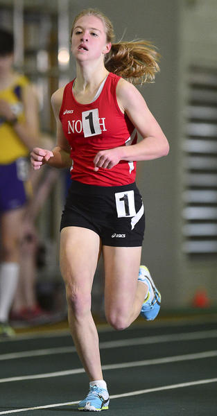 North Hagerstown's Emily Ward is on her way to a meet-record time of 5:13.25 in the girls 1,600-meter run at the Washington County Indoor Track & Field Championships on Friday at Hagerstown Community College.