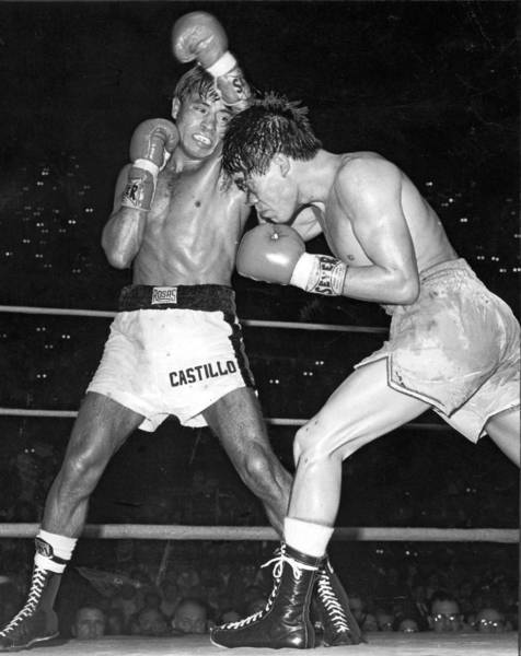 Ruben Olivares, right, and Jesus 'Chucho' Castillo are shown during one of their three fights at the Forum in the early 1970s. The fights cemented Castillo's reputation with L.A. fight fans.