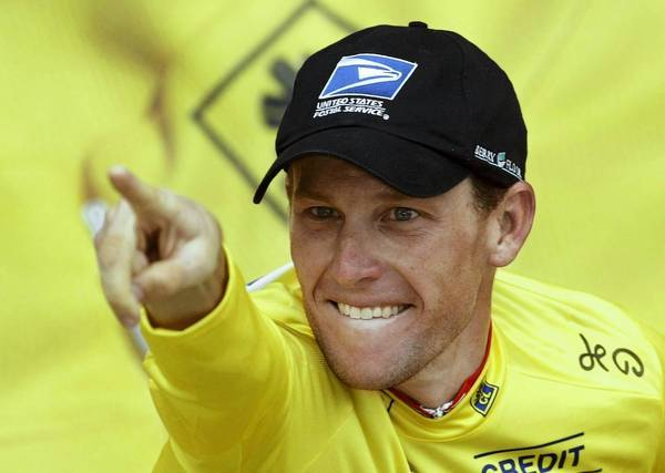"Lance Armstrong celebrates after winning a stage of the Tour de France in 2003. Robert Feldman, a leading researcher on the psychology of lying, says that in the case of Armstrong's deception, ""he was pretty confident he could get away with it."""