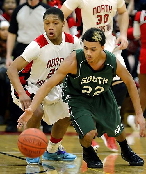 South Hagerstown's Michael Hill reaches to control the ball ahead of North Hagerstown's Isaiah Keyes on Friday during the Hubs' 67-63 victory.