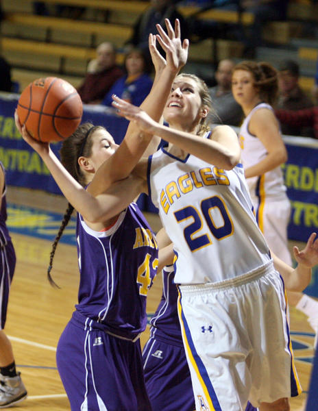Aberdeen Central's Samantha Knecht, right, tries to lay up a shot under the defense of Watertown's Mandy Tetzlaff, left, during Friday night's game at the Golden Eagles Arena.