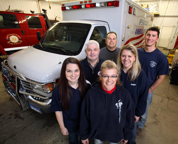 Barb Gorczewski, director of the Ipswich Ambulance Service, front center, is seen with some of her volunteer staff members, from left: Kelsey Holien, Mike Hammrich, Mike Heinz, Amber Toay and Tracy Hutson.