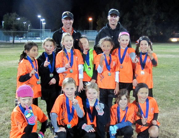 The AYSO Region 57 (Corona del Mar) girls' under-9 Orange Crush Fall Recreation team captured the Area Q championship.