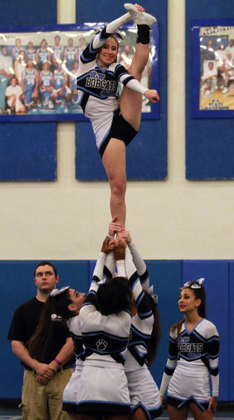West Broward High school cheerleaders compete in the state regional cheerleading competition at Dillard .